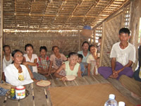 villagers gather for a worship service